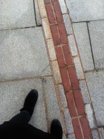 Brick demarkations in the sidewalk to follow the freedom trail