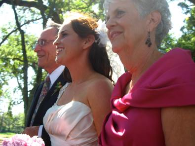 Debbie and her parents walk down the isle