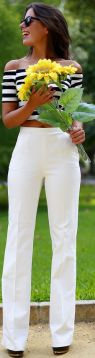 Over the shoulder top softens a broad top. White pants help to create visual balance.